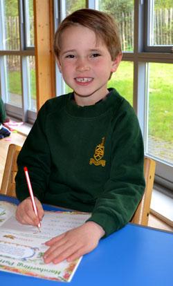 School Boy practicing handwriting